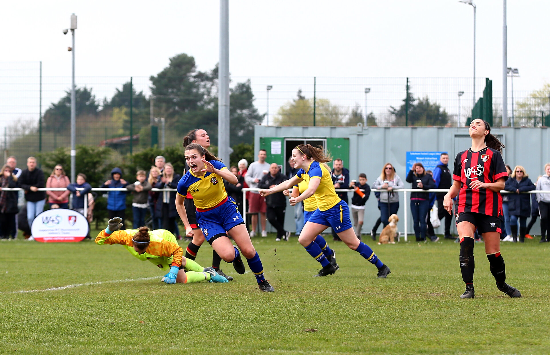 Chloe Newton wheels away to celebrate after opening the scoring during the match between AFCB Women v Southampton FC Women, at Verwood Town FC, Verwood, 31st March 2019