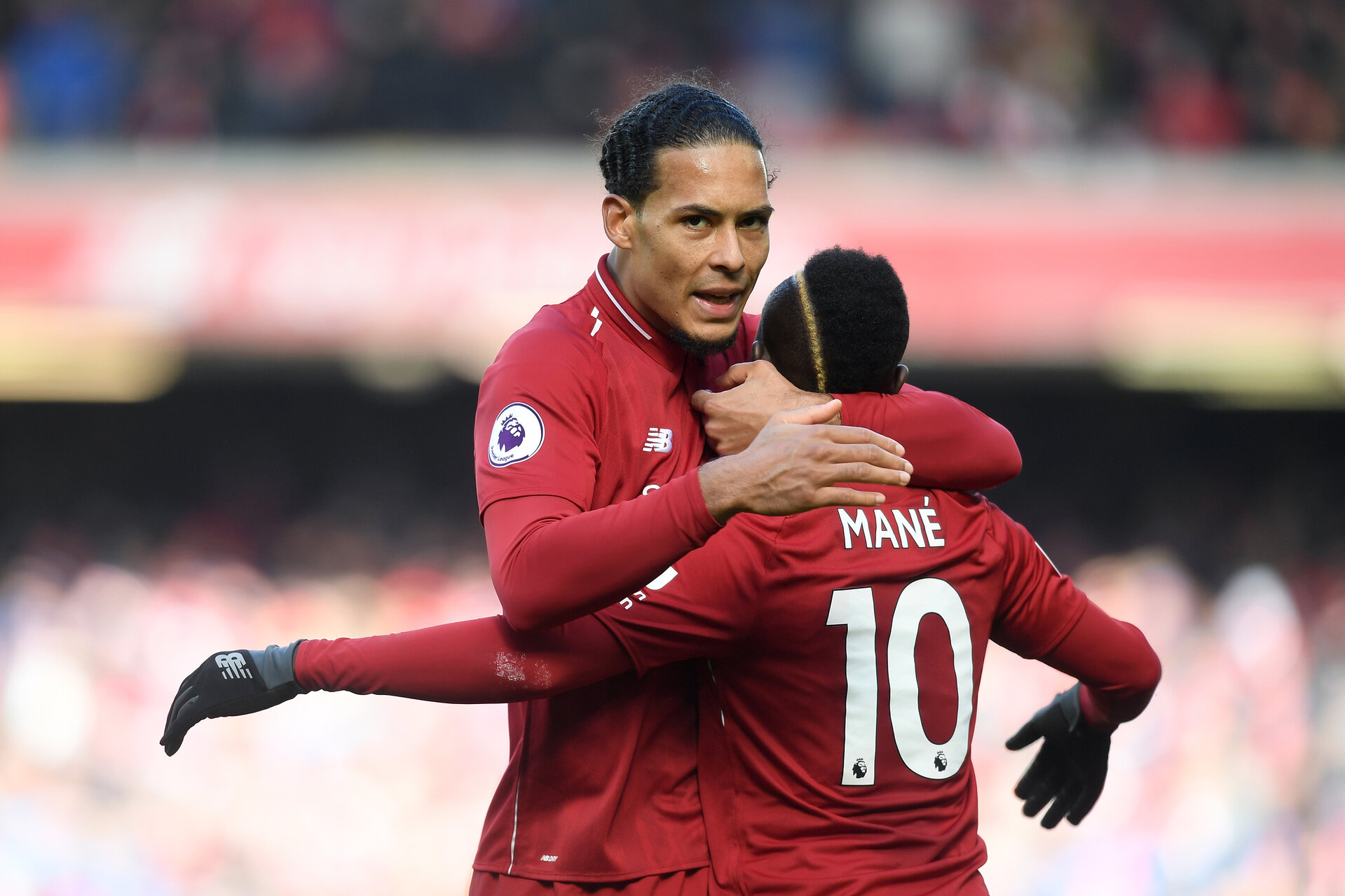 LIVERPOOL, ENGLAND - MARCH 10: Sadio Mane of Liverpool celebrates with Virgil van Dijk of Liverpool after scoring his sides fourth goal during the Premier League match between Liverpool FC and Burnley FC at Anfield on March 10, 2019 in Liverpool, United Kingdom. (Photo by Michael Regan/Getty Images)