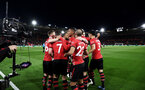 SOUTHAMPTON, ENGLAND - APRIL 05: Players of Southampton celebrate in front of tv cameras after Shane Long scores during the Premier League match between Southampton FC and Liverpool FC at St Mary's Stadium on April 6, 2019 in Southampton, United Kingdom. (Photo by Matt Watson/Southampton FC via Getty Images)