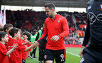 SOUTHAMPTON, ENGLAND - APRIL 13: Danny Ings meets Saints Foundation mascots during the Premier League match between Southampton FC and Wolverhampton Wanderers at St Mary's Stadium on April 13, 2019 in Southampton, United Kingdom. (Photo by Matt Watson/Southampton FC via Getty Images)