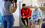 SOUTHAMPTON, ENGLAND - APRIL 17: Charlie Austin (middle) of Southampton FC visits Southampton General Hospital pictured with patients on April 17, 2019 in Southampton, England. (Photo by James Bridle - Southampton FC/Southampton FC via Getty Images)