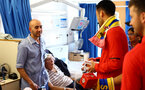 SOUTHAMPTON, ENGLAND - APRIL 17: Maya Yoshida (right) of Southampton FC visits Southampton General Hospital pictured with patients and staff on April 17, 2019 in Southampton, England. (Photo by James Bridle - Southampton FC/Southampton FC via Getty Images)