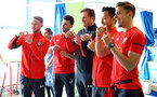 SOUTHAMPTON, ENGLAND - APRIL 17: LtoR Callum Slattery, Shane Long, Ralph Hasenhuttl, Maya Yoshida, Jan Bednarek uses sign language to message a patient via mobile during a visit to Southampton General Hospital pictured on April 17, 2019 in Southampton, England. (Photo by James Bridle - Southampton FC/Southampton FC via Getty Images)