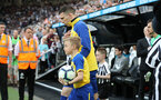 NEWCASTLE UPON TYNE, ENGLAND - APRIL 20: Pierre-Emile Hojbjerg of Southampton leads the team out with the match day mascot during the Premier League match between Newcastle United and Southampton FC at St. James Park on April 20, 2019 in Newcastle upon Tyne, United Kingdom. (Photo by Matt Watson/Southampton FC via Getty Images)
