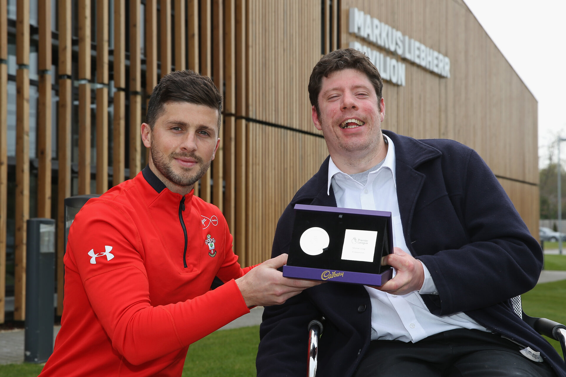SOUTHAMPTON, ENGLAND - APRIL 16: Guest presenter Chris presents Shane Long of Southampton with his 50th Premier League Goal Milestone Award on April 16, 2019 at Staplewood Complex on April 16, 2019 in Southampton, England. (Photo by Steve Bardens/Getty Images) *** Local Caption *** Shane Long