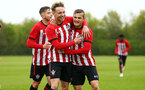 NORWICH, ENGLAND - APRIL 27: Sean Keogh scores (left) and celebrates with Kornelius Hansen (right) during a U18 Premier League match between Norwich City FC and Southampton FC pictured at Colney Training Ground on April 27, 2019 in Norwich, England. (Photo by James Bridle - Southampton FC/Southampton FC via Getty Images)