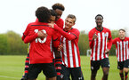 NORWICH, ENGLAND - APRIL 27: Christian Norton in scores and celebrates (middle) with Rio Glean (back-centre) Kornelius Hansen (right)  during a U18 Premier League match between Norwich City FC and Southampton FC pictured at Colney Training Ground on April 27, 2019 in Norwich, England. (Photo by James Bridle - Southampton FC/Southampton FC via Getty Images)