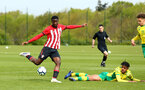NORWICH, ENGLAND - APRIL 27: Rowland Idowu scores (left) during a U18 Premier League match between Norwich City FC and Southampton FC pictured at Colney Training Ground on April 27, 2019 in Norwich, England. (Photo by James Bridle - Southampton FC/Southampton FC via Getty Images)