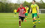 NORWICH, ENGLAND - APRIL 27: Kornelius Hansen scores and celebrates (middle) during a U18 Premier League match between Norwich City FC and Southampton FC pictured at Colney Training Ground on April 27, 2019 in Norwich, England. (Photo by James Bridle - Southampton FC/Southampton FC via Getty Images)