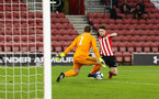 SOUTHAMPTON, ENGLAND - APRIL 29: Will Ferry (right) almost gets past the goal keeper during the Premier League 2 match between Southampton FC and Sunderland pictured at St Mary's Stadium on April 29, 2019 in Southampton, England. (Photo by James Bridle - Southampton FC/Southampton FC via Getty Images)