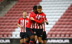 SOUTHAMPTON, ENGLAND - MAY 03: Will Smallbone (right) of Southampton celebrates with Dan Nlundulu (left) after scoring from the penalty spot during the U23s PL2 Play off Semi-Final between Southampton FC and Aston Villa FC pictured at St Mary's Stadium on May 03, 2019 in Southampton, England. (Photo by James Bridle - Southampton FC/Southampton FC via Getty Images)