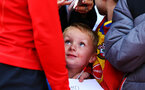 SOUTHAMPTON, ENGLAND - MAY 08: a young fan awaits signatures from players during a Southampton FC open training session at St Mary's Stadium on May 08, 2019 in Southampton, England. (Photo by James Bridle - Southampton FC/Southampton FC via Getty Images)