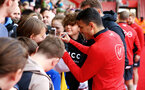 SOUTHAMPTON, ENGLAND - MAY 08: Mohamed Elyounoussi signs fans merchandise (right) during a Southampton FC open training session at St Mary's Stadium on May 08, 2019 in Southampton, England. (Photo by James Bridle - Southampton FC/Southampton FC via Getty Images)