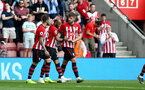SOUTHAMPTON, ENGLAND - MAY 12: Nathan Redmond(centre) of Southampton celebrates his goal with Danny Ings(L) and Jack Stephens(R) during the Premier League match between Southampton FC and Huddersfield Town at St Mary's Stadium on May 12, 2019 in Southampton, United Kingdom. (Photo by Matt Watson/Southampton FC via Getty Images)