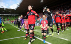 SOUTHAMPTON, ENGLAND - MAY 12: Pierre-Emile Hojbjerg leads the team onto the pitch with the match day mascots during the Premier League match between Southampton FC and Huddersfield Town at St Mary's Stadium on May 12, 2019 in Southampton, United Kingdom. (Photo by Matt Watson/Southampton FC via Getty Images)