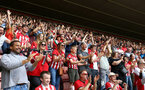 SOUTHAMPTON, ENGLAND - MAY 12: Fans react as Nathan Redmond scores for Southampton FC during the Premier League match between Southampton FC and Huddersfield Town at St Mary's Stadium on May 12, 2019 in Southampton, United Kingdom. (Photo by James Bridle - Southampton FC/Southampton FC via Getty Images)