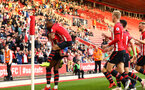 SOUTHAMPTON, ENGLAND - MAY 13: Dan Nlundulu (left) scores for Southampton and celebrates while Tyreke Johnson (middle)  jumps on his back during the U23s PL2 Play off final between Southampton and Newcastle United pictured at St. Mary's Stadium on May 13, 2019 in Southampton, England. (Photo by James Bridle - Southampton FC/Southampton FC via Getty Images)