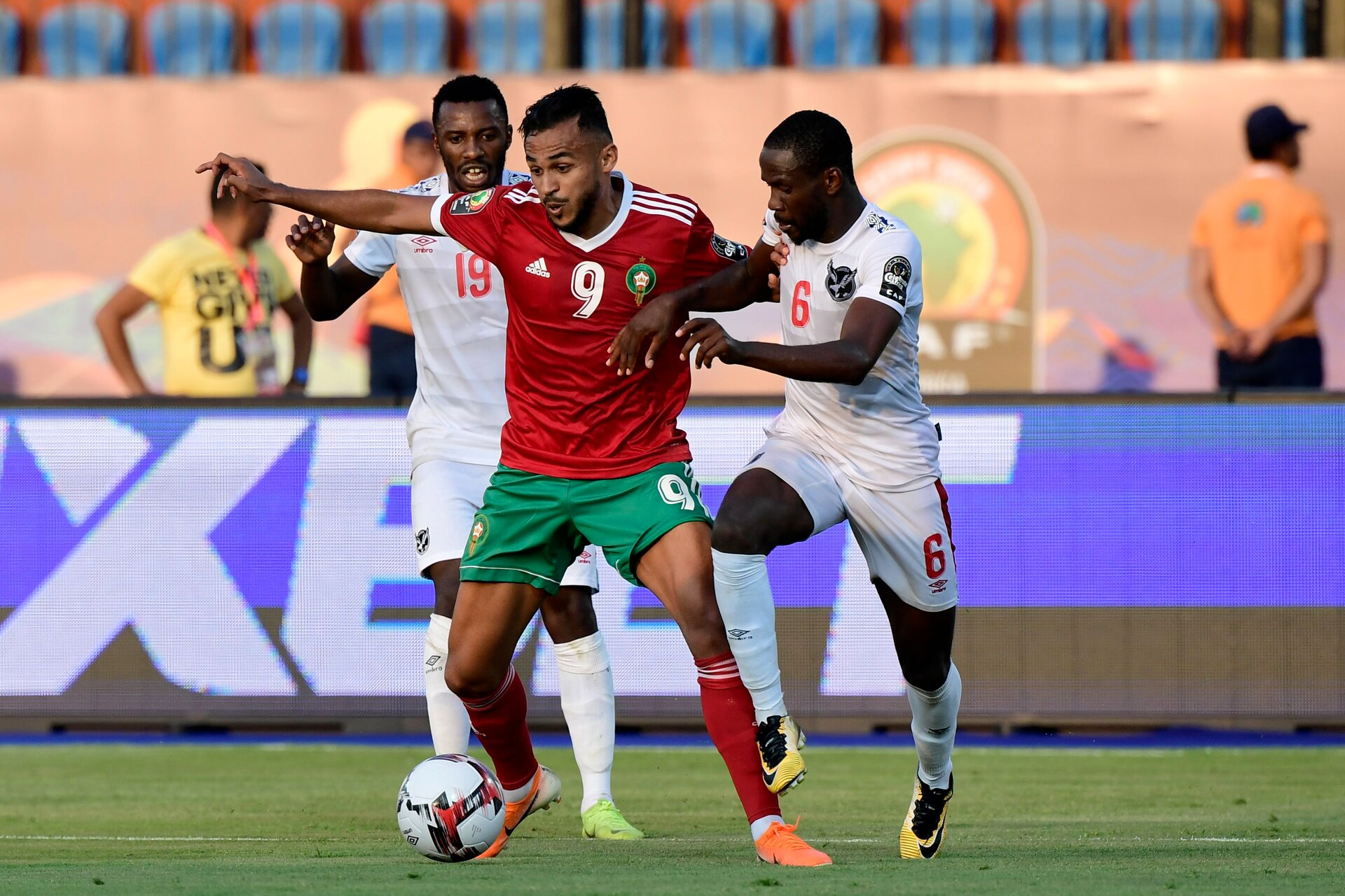 Morocco's forward Sofiane Boufal (C) is marked by Namibia's midfielder Petrus Shitembi (L) and Namibia's midfielder Larry Horaeb during the 2019 Africa Cup of Nations (CAN) football match between Morocco and Namibia at the Al Salam Stadium in Cairo on June 23, 2019. (Photo by JAVIER SORIANO / AFP)        (Photo credit should read JAVIER SORIANO/AFP/Getty Images)