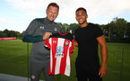 SOUTHAMPTON, ENGLAND - JUNE 30: Southampton FC's latest signing Che Adams(R) with manager Ralph Hasenhuttl, pictured at the Staplewood Campus on June 30, 2019 in Southampton, England. (Photo by Matt Watson/Southampton FC via Getty Images)