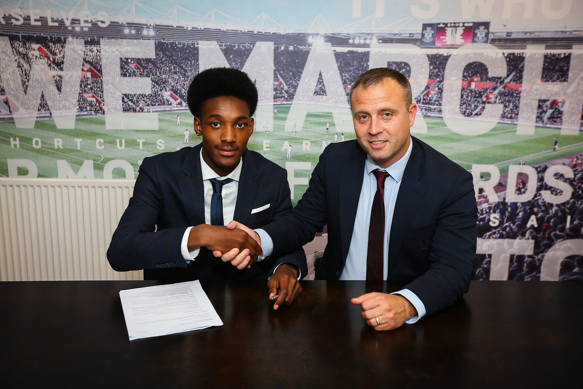 SOUTHAMPTON, ENGLAND - 28 JUNE: Ramello Mitchell (left) signs as a first year scholar with Southampton FC on June 28, 2018 pictured at St Marys Stadium, Southampton, England. (Photo by James Bridle - Southampton FC/Southampton FC via Getty Images)