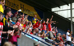 PRESTON, ENGLAND - JULY 20: Fans celebrate as Southampton FC score during the second half of the pre-season friendly game between Preston North End and Southampton FC pictured at Deepdale on July 20, 2019 in Preston, England. (Photo by James Bridle - Southampton FC/Southampton FC via Getty Images)