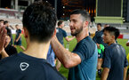 Shane Long meets young local players during a Southampton FC training session while on their Pre Season trip to Macau, China, 22nd July 2019