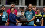 MACAU, MACAU - JULY 23: Maya Yoshida of Southampton is presented with a winners trophy during the pre-season friendly match between Guangzhou R&F and Southampton, on July 23, 2019 at the Estadio Campo Desportivo in Macau, Macau. (Photo by Matt Watson/Southampton FC via Getty Images)