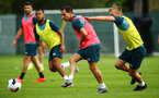 DUBLIN, ENGLAND - JULY 27: Cedric Soares (middle) taken on by James Ward-Prowse (right) during a Southampton FC Training session pictured at Carton House Spa and Resort for Pre-Season Training on July 27, 2019 in Southampton, England. (Photo by James Bridle - Southampton FC/Southampton FC via Getty Images)