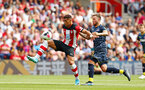 SOUTHAMPTON, ENGLAND - AUGUST 03: Che Adams (left) during the Pre-Season Friendly match between Southampton FC and FC Kšln pictured at St. Mary's Stadium on August 03, 2019 in Southampton, England. (Photo by James Bridle - Southampton FC/Southampton FC via Getty Images) SOUTHAMPTON, ENGLAND - AUGUST 03: Che Adams (left) during the Pre-Season Friendly match between Southampton FC and FC Köln pictured at St. Mary's Stadium on August 03, 2019 in Southampton, England. (Photo by James Bridle - Southampton FC/Southampton FC via Getty Images)