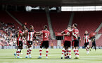 SOUTHAMPTON, ENGLAND - AUGUST 03: Southampton players celebrate after Danny Ings(9) of Southampton opens the scoring during the Pre-Season Friendly match between Southampton FC and FC Köln at St. Mary's Stadium on August 03, 2019 in Southampton, England. (Photo by Matt Watson/Southampton FC via Getty Images,)