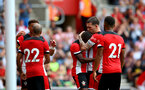 SOUTHAMPTON, ENGLAND - AUGUST 03: Pierre-Emile Hojbjerg(R) of Southampton embraces Michael Obafemi during the Pre-Season Friendly match between Southampton FC and FC Köln at St. Mary's Stadium on August 03, 2019 in Southampton, England. (Photo by Matt Watson/Southampton FC via Getty Images,)