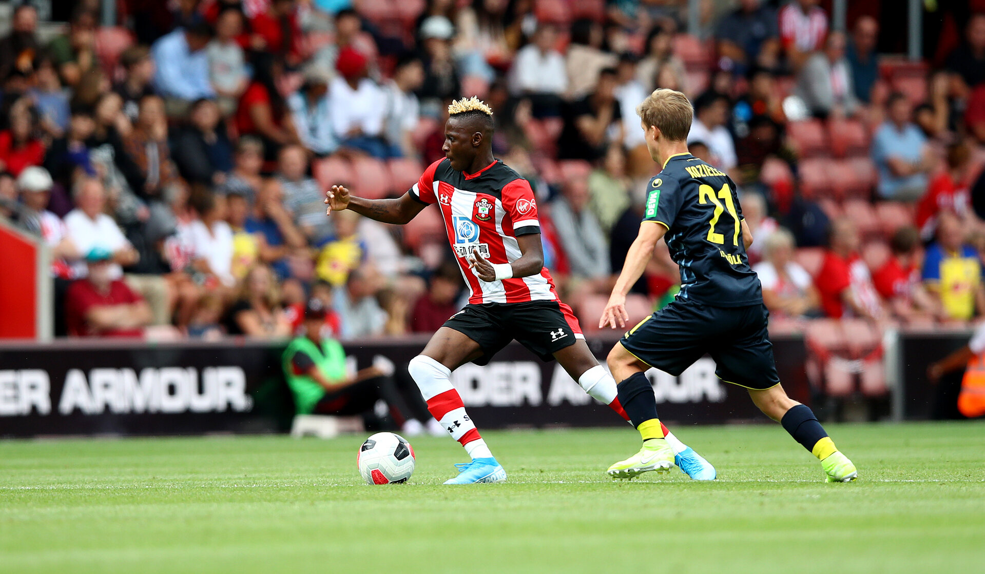 SOUTHAMPTON, ENGLAND - AUGUST 03: Moussa Djenepo of Southampton during the Pre-Season Friendly match between Southampton FC and FC Köln at St. Mary's Stadium on August 03, 2019 in Southampton, England. (Photo by Matt Watson/Southampton FC via Getty Images,)