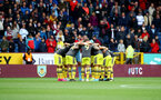 BURNLEY, ENGLAND - AUGUST 10: Saints players huddle during the Premier League match between Burnley FC and Southampton FC at Turf Moor on August 10, 2019 in Burnley, United Kingdom. (Photo by Matt Watson/Southampton FC via Getty Images)