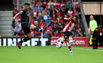 SOUTHAMPTON, ENGLAND - AUGUST 17: Ryan Bertrand(R) of Southampton and Roberto Firminho of Liverpool during the Premier League match between Southampton FC and Liverpool FC at St Mary's Stadium on August 17, 2019 in Southampton, United Kingdom. (Photo by Matt Watson/Southampton FC via Getty Images)