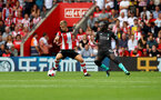 SOUTHAMPTON, ENGLAND - AUGUST 17: James Ward-Prowse(L) of Southampton and Saido Mane of Liverpool during the Premier League match between Southampton FC and Liverpool FC at St Mary's Stadium on August 17, 2019 in Southampton, United Kingdom. (Photo by Matt Watson/Southampton FC via Getty Images)