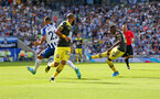 BRIGHTON, ENGLAND - AUGUST 24: Moussa Djenepo(R) of Southampton opens the scoring during the Premier League match between Brighton & Hove Albion and Southampton FC at American Express Community Stadium on August 24, 2019 in Brighton, United Kingdom. (Photo by Matt Watson/Southampton FC via Getty Images)