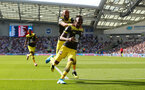 BRIGHTON, ENGLAND - AUGUST 24: Moussa Djenepo(R) of Southampton celebrates his goal with team mate Nathan Redmond(L) during the Premier League match between Brighton & Hove Albion and Southampton FC at American Express Community Stadium on August 24, 2019 in Brighton, United Kingdom. (Photo by Matt Watson/Southampton FC via Getty Images)