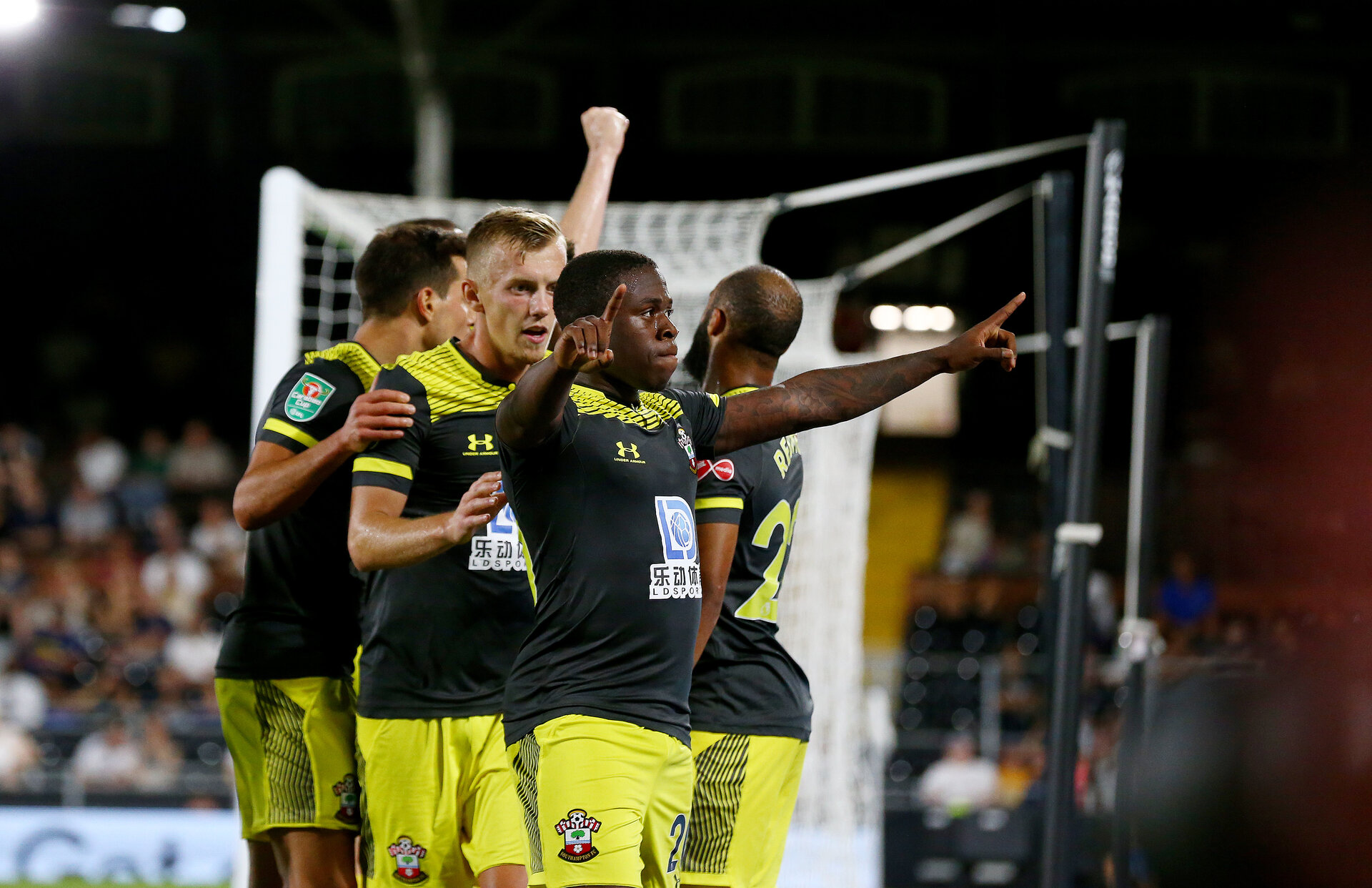 LONDON, ENGLAND - AUGUST 27: Michael Obafemi of Southampton celebrates after opening the scoring  during the Carabao Cup second round match between Fulham and Southampton FC at Craven Cottage on August 27, 2019 in London, England. (Photo by Matt Watson/Southampton FC via Getty Images)
