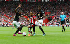 SOUTHAMPTON, ENGLAND - AUGUST 31: Sofiane Boufal(centre) up against Aaron Wan-Bissaka(L) and Paul Pogba of Manchester United(R) during the Premier League match between Southampton FC and Manchester United at St Mary's Stadium on August 31, 2019 in Southampton, United Kingdom. (Photo by Matt Watson/Southampton FC via Getty Images)