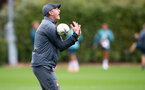SOUTHAMPTON, ENGLAND - SEPTEMBER 22: Ralph Hasenhuttl attempts to catch a rugby ball during a training session at the Staplewood Campus on September 22, 2019 in Southampton, England. (Photo by Matt Watson/Southampton FC via Getty Images)