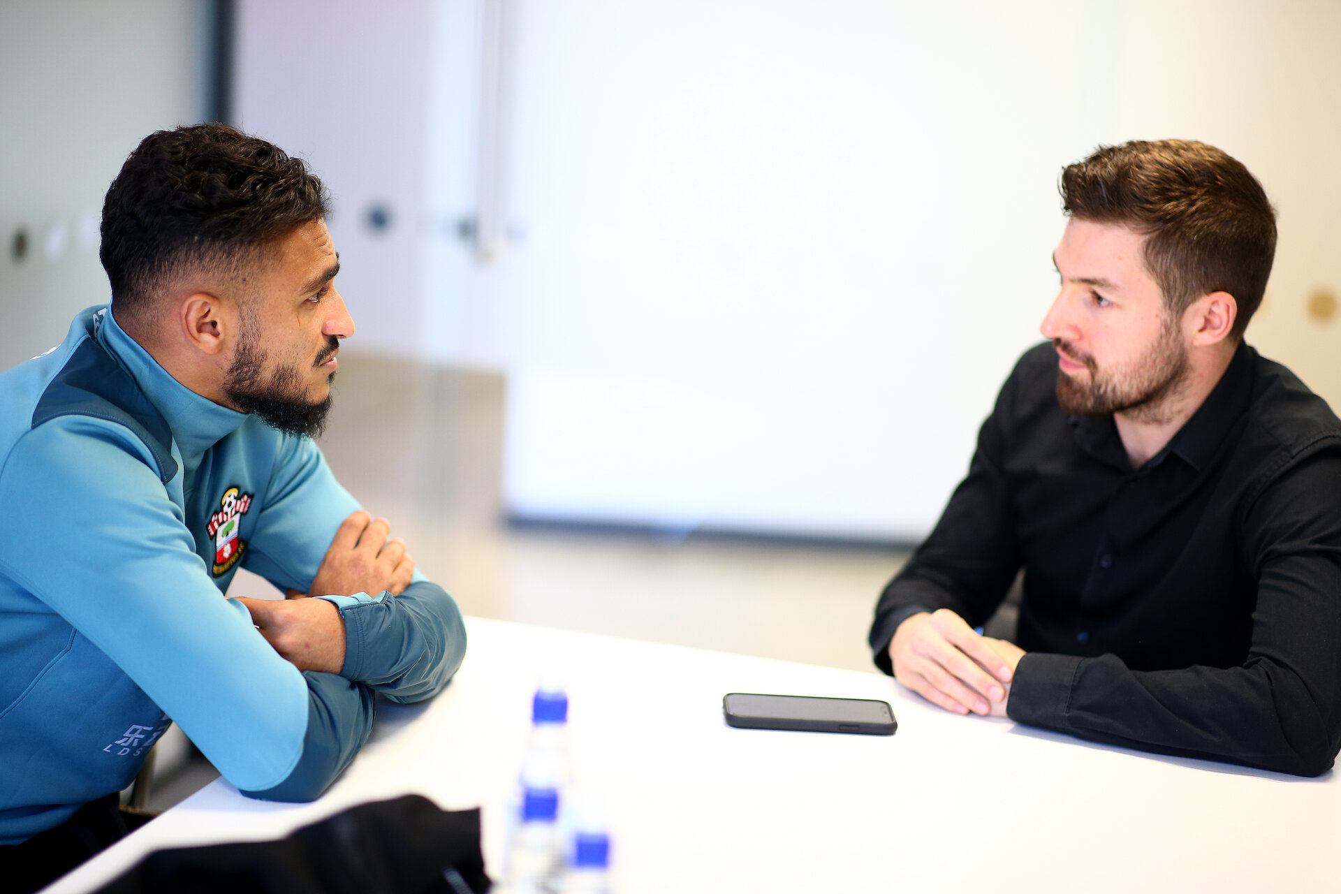 SOUTHAMPTON, ENGLAND - OCTOBER 02: Sofiane Boufal(L) of Southampton FC pictured being interviewed by Mark Perrow for the club's match day magazine at the Staplewood Campus on October 02, 2019 in Southampton, England. (Photo by Matt Watson/Southampton FC via Getty Images)