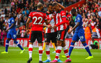 SOUTHAMPTON, ENGLAND - OCTOBER 6: Yan Valery of Southampton FC is congratulated by Nathan Redmond and Ryan Bertrand of Southampton FC after assisting Southampton's first goal during the Premier League match between Southampton FC and Chelsea FC at St Mary's Stadium on October 6, 2019 in Southampton, England of Southampton FC and during the Premier League match between Southampton FC and Chelsea FC at St Mary's Stadium on October 6, 2019 in Southampton, England