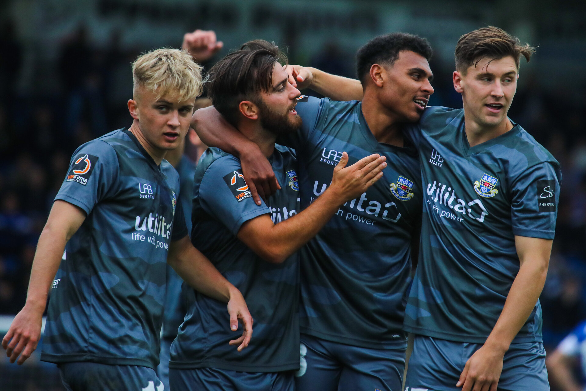 CHESTERFIELD, ENGLAND - OCTOBER 5: Marcus Barnes of Southampton FC (on loan at Eastleigh FC) celebrates with Eastleigh teammates after scoring his side's second goal during the Vanarama National League match between Chesterfield FC and Eastleigh FC at the Proact Stadium on October 5, 2019 in Chesterfield, England