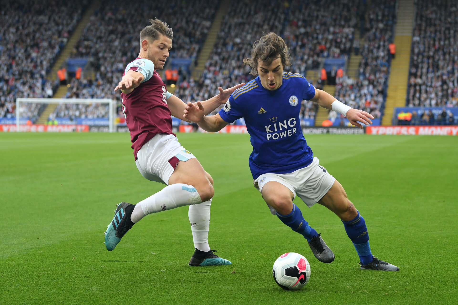 LEICESTER, ENGLAND - OCTOBER 19: Caglar Soyuncu of Leicester City battles for possession with James Tarkowski of Burnley during the Premier League match between Leicester City and Burnley FC at The King Power Stadium on October 19, 2019 in Leicester, United Kingdom. (Photo by Michael Regan/Getty Images)