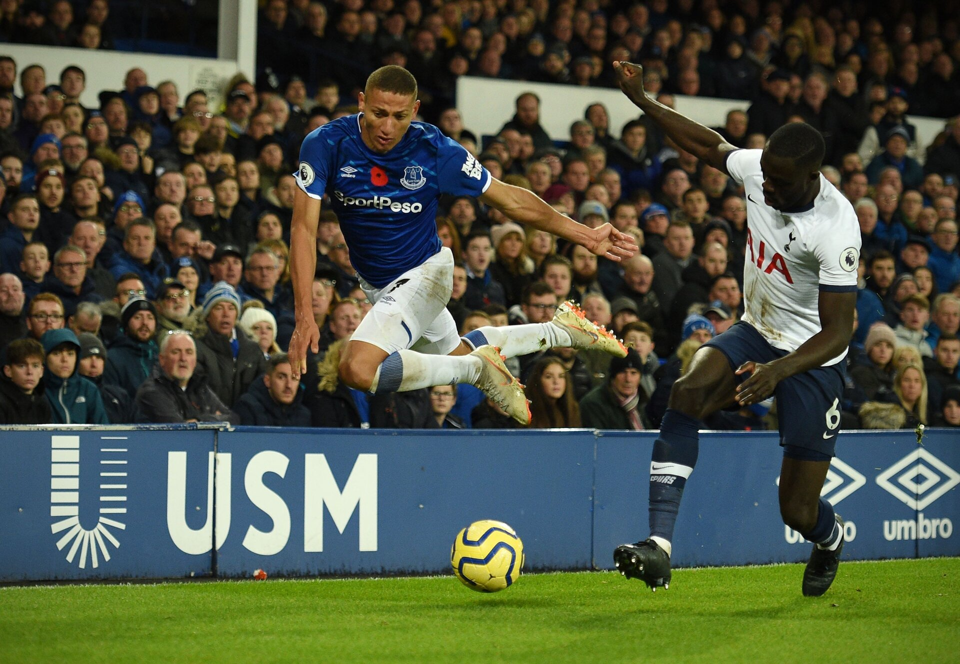 Everton's Brazilian striker Richarlison (L) vies with Tottenham Hotspur's Colombian defender Davinson Sanchez (R) during the English Premier League football match between Everton and Tottenham Hotspur at Goodison Park in Liverpool, north west England on November 3, 2019. (Photo by Oli SCARFF / AFP) / RESTRICTED TO EDITORIAL USE. No use with unauthorized audio, video, data, fixture lists, club/league logos or 'live' services. Online in-match use limited to 120 images. An additional 40 images may be used in extra time. No video emulation. Social media in-match use limited to 120 images. An additional 40 images may be used in extra time. No use in betting publications, games or single club/league/player publications. /  (Photo by OLI SCARFF/AFP via Getty Images)