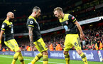LONDON, ENGLAND - NOVEMBER 23: L to R Nathan Redmond, Danny Ings and James Ward-Prowse(scorer) of Southampton celebrate after their team goes 2-1 up during the Premier League match between Arsenal FC and Southampton FC at Emirates Stadium on November 23, 2019 in London, United Kingdom. (Photo by Matt Watson/Southampton FC via Getty Images)