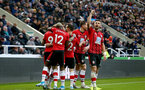 NEWCASTLE UPON TYNE, ENGLAND - DECEMBER 08: Shane Long(R) of Southampton celebrates after Danny Ings scores during the Premier League match between Newcastle United and Southampton FC at St. James Park on December 08, 2019 in Newcastle upon Tyne, United Kingdom. (Photo by Matt Watson/Southampton FC via Getty Images)