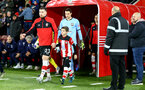 SOUTHAMPTON, ENGLAND - DECEMBER 14: Pierre-Emile Hojbjerg of Southampton leads the teams out with the match day mascot during the Premier League match between Southampton FC and West Ham United at St Mary's Stadium on December 14, 2019 in Southampton, United Kingdom. (Photo by Matt Watson/Southampton FC via Getty Images)