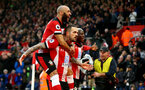 SOUTHAMPTON, ENGLAND - JANUARY 01: Danny Ings(centre of Southampton celebrates with Nathan Redmond(L) and Moussa Djenepo(R)  after opening the scoring during the Premier League match between Southampton FC and Tottenham Hotspur at St Mary's Stadium on January 01, 2020 in Southampton, United Kingdom. (Photo by Matt Watson/Southampton FC via Getty Images)