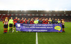 SOUTHAMPTON, ENGLAND - JANUARY 04: The two teams combine for a photo to raise awareness of mental health during the FA Cup Third Round match between Southampton FC and Huddersfield Town at St. Mary's Stadium on January 04, 2020 in Southampton, England. (Photo by Matt Watson/Getty Images)